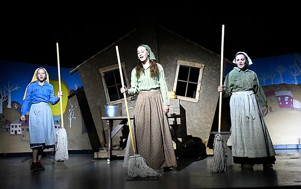 (left to right) Taryn Roberts, Sage Kroeker and Isabel Giles rehearse a song in the Oklahoma Bible Academy production of Fiddler on the Roof Thursday November 16, 2017. (Billy Hefton / Enid News & Eagle)