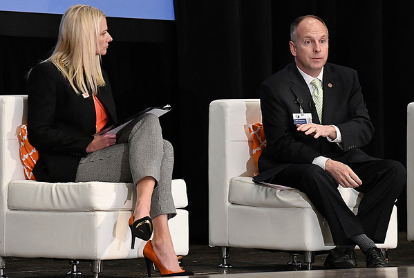 Moderator Dr. Kayse Shrum listens to Jeffery Hickman as he talks during the Addiction in Rural Oklahoma Summit on the opioid crisis Wednesday November 8, 2017 at the Central National Bank Center. (Billy Hefton / Enid News & Eagle)