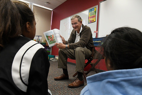 Enid mayor, Bill Shewey, reads to students during a meeting of the Marshallese Club at Coolidge Elementary Monday November 5, 2018. (Billy Hefton / Enid News & Eagle)