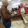 Sen. Roland Pederson serves dessert to Judy Jetton at RSVP Senior Center Monday November 5, 2018 during the United Way of Enid & NW Oklahoma Day of Kindness. (Billy Hefton / Enid News & Eagle)
