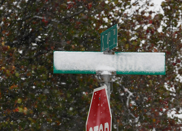 A north facing street sign is covered with snow at the intersection of Oklahoma and 4th Monday November 12, 2018. (Billy Hefton / Enid News & Eagle)