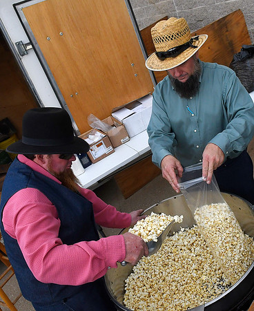 Steven Yoder and Ernest Miller bag kettle corn at the Oklahoma Mennonite Relief Sale at Friday November 2, 2018 the Garfield County Fairgrounds. The sale continues Saturday 7 a.m. - 2 p.m. (Billy Hefton / Enid News & Eagle)