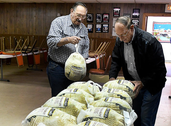 Leroy Patocka and Al Patocka unbox turkeys at the Knights of Columbus building Friday November 16, 2018.. The turkeys will be served during the annual free meal Thanksgiving day at St. Francis Xavier Catholic Church. (Billy Hefton / Enid News & Eagle)