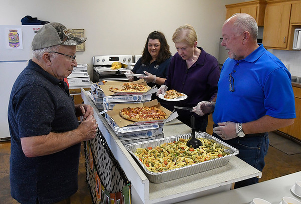 Wendy Franke, Kathleen and Russ Parker serve lunch to Frank Beneditti at RSVP Senior Center Monday November 5, 2018 during the United Way of Enid & NW Oklahoma Day of Kindness. (Billy Hefton / Enid News & Eagle)