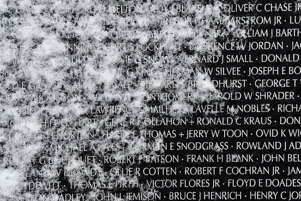 Snow clings to the Vietnam Memorial Wall at the Woodring Wall of Honor and Veterans Park Monday November 12, 2018. (Billy Hefton / Enid News & Eagle)