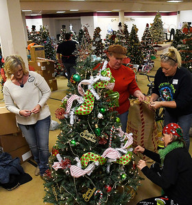 (left to right) Vickie Schroeder, Sondra Hernandez, Natalie McGee and Tammy Mitch decorate a tree at the Salvation Army Angel Tree store inside Oakwood Mall Friday November 30, 2018. The last day to donate to the Angel Tree program is December 15. (Billy Hefton / Enid News & Eagle)