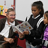 Enid mayor, Bill Shewey, listens to Jamie Lokkejak and Molia Billet while they read colors in Marshallese during a meeting of the Marshallese Club at Coolidge Elementary Monday November 5, 2018. (Billy Hefton / Enid News & Eagle)