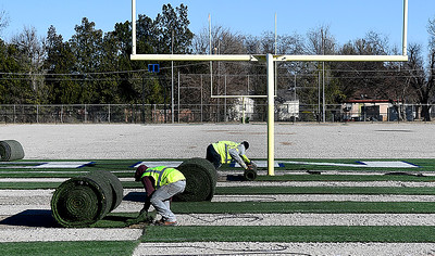 Workers remove the artificial turf at D. Bruce Selby Stadium Tuesday, November 12, 2019 in preparation for new turf to be installed. (Billy Hefton / Enid News & Eagle)