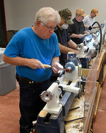 Members of the Nortwest Oklahoma Woodturners at the Mennonite Relief Sale Saturday November 2, 2019 at the Garfield County Fairgrapunds. (Billy Hefton / Enid News & Eagle)