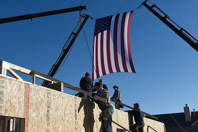 Volunteers work on a home being built by World Mission Builders for a wounded veteran Friday, November 15, 2019. (Billy Hefton / Enid News & Eagle)