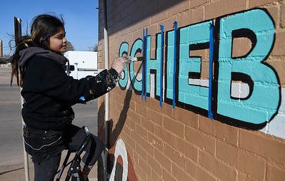 Paulina Capicúa does some final touch ups on a new Schieber's Donuts and Deli logo Thursday, November 14m 2019. (Billy Hefton / Enid News & Eagle)