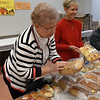 Penny Payne and Karen Neufeld work the Bread Basket booth at the Mennonite Relief Sale Saturday November 2, 2019 at the Garfield County Fairgrapunds. (Billy Hefton / Enid News & Eagle)