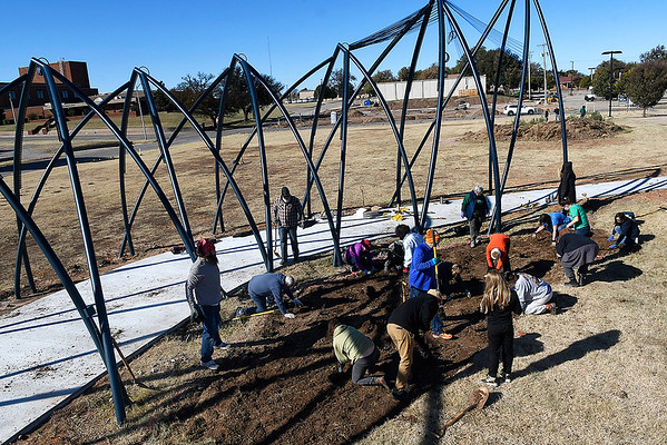 """Volunteers landscape the art project """"Under Her Wing Was the Universe"""" Saturday November 2, 2019. (Billy Hefton / Enid News & Eagle)"""