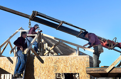 Joe Wilson, Norman Schipull and Mark Harbaugh work on a home being built by World Mission Builders for a wounded veteran Friday, November 15, 2019. (Billy Hefton / Enid News & Eagle)