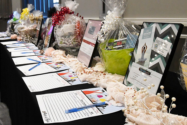 Some of the items in the silent auction during the Meals in Heels luncheon Friday, November 1, 2019 at the Stride Bank Center. (Billy Hefton / Enid News & Eagle)