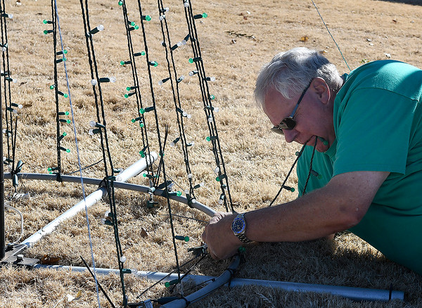 Dick Yuhnke works on setting up his Christmas light display Monday, Noveember 18, 2019 at his home on Pheasant Run Drive. (Billy Hefton / Enid News & Eagle)