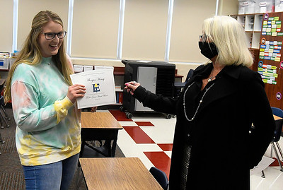 Coolidge Emementary teacher, Morgan Henry, accepts a grant from Enid Public School Foundation Signature Grant Donor, Kelly Henry, Friday, November 13, 2020. (Billy Hefton / Enid News & Eagle)