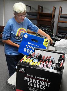 Rhonda Stevison, of Enid SOS, picks up donated items at the United Way office Thursday, November 12, 2020. (Billy Hefton / Enid News & Eagle)