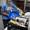 Rhonda Stevison, of Enid SOS, picks up donated items at the United Way office Thursday, November 12, 2020. (Billy Hefton / Enid News & Eagle)
