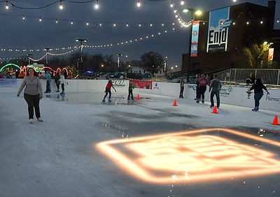 People skate during the opening night of the downtown ice rink Friday, November 20, 2020. (Billy Hefton / Enid News & Eagle)