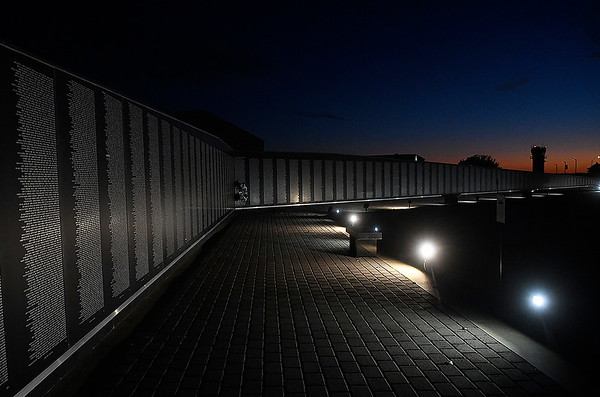 Lights illuminate the Vietnam Memorial Wall at the Woodring Wall of Honor and Veterans Park just after sunset Tuesday, November 10, 2020. (Billy Hefron / Enid News & Eagle)