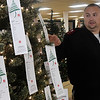 Salvation Army Capt. David Brittle gestures towards an Angel Tree during an interview Tuesday, November 17, 2020 at the Salvation Army Angel Tree store inside Oakwood Mall. (Billy Hefton / Enid News & Eagle)