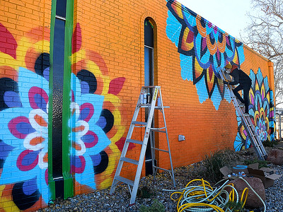 Chris Bodelle, co-owner of Blood Brothers Tattoo, works on a mural for the Pediadent Building Monday, November 30, 2020. (Billy Hefton / Enid News & Eagle)