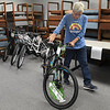Rhonda Stevison, of Enid SOS, rolls away a donated bicycle at the United Way office Thursday, November 12, 2020. (Billy Hefton / Enid News & Eagle)