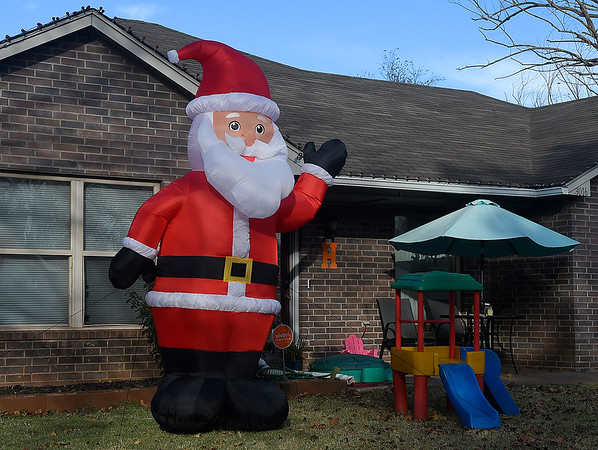 A large inflatable Santa waves from the yard of a house on Hillcrest street Thursday, November 12, 2020. (Billy Hefton / Enid News & Eagle)