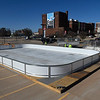 Workers move a set of bleachers into place next to an ice rink in downtown Enid Monday, November 16, 2020. The rink is scheduled to open November 20 and remain open through January 3. (Billy Hefton / Enid News & Eagle)