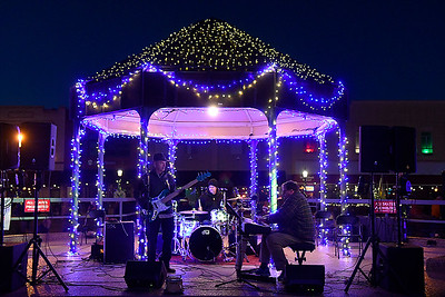 The Bill Collectors perform during Light Up the Plains Friday, November 27, 2020 in downtown Enid. (Billy Hefton / Enid News & Eagle)