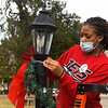 NOC Enid basketball player, Leisha Hester, hangs Christmas decorations at Humphrey Heritage Village Friday, November 13, 2020. Hester was among several NOC Enid athletes to take part in the Day of Kindness. (Billy Hefton / Enid News & Eagle)
