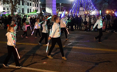 members of the Enid Twirling Academy march down Grand Ave. during Light Up the Plains parade Friday, November 27, 2020 in downtown Enid. (Billy Hefton / Enid News & Eagle)