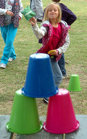 Seven Merriott takes part in the games Sunday during the YMCA Family Fun Day at Government Springs Park. (Staff Photo by BILLY HEFTON)