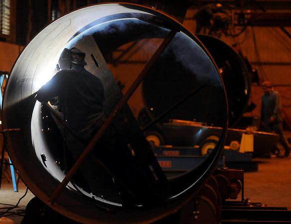 Rolando Vega back-welds a nozzle at Pelagic Tank, LLC. (Staff Photo by BONNIE VCULEK)