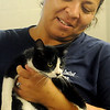 Enid Animal Control volunteer Christina Brundzo holds one of the cats that is available for adoption during the center's open house and ground-breaking ceremony Saturday. (Staff Photo by BONNIE VCULEK)