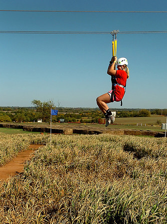 Katie Durbin rides over the maze on the newly added zip line at Daze in a Maze located south of Covington. (Staff Photo by BILLY HEFTON)