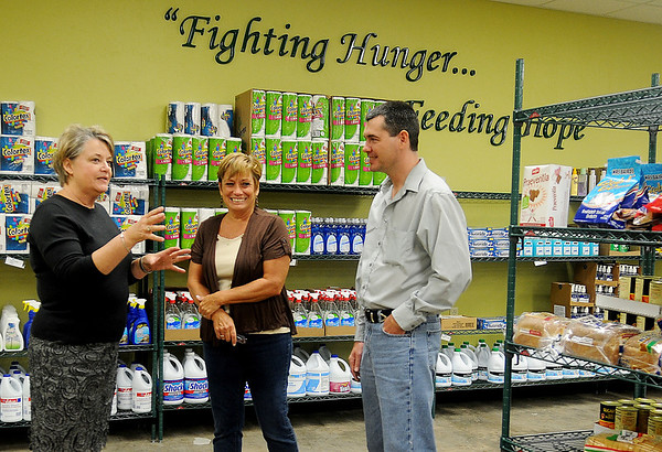 Gail Wynne (left) gives Carol Broughton and Chris Sweatt a tour of the interior of Loaves & Fishes NW Oklahoma Thursday. The grand opening of the client pantry will be Tuesday, Oct. 23 from 11 a.m. - 2:30 p.m. (Staff Photo by BONNIE VCULEK)