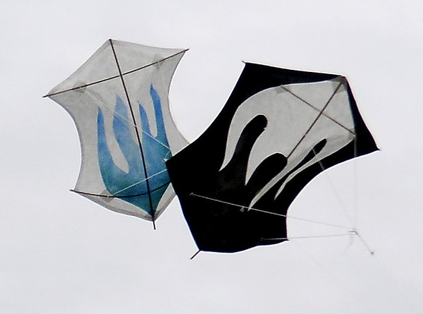Two mini Rokkaku kites compete during a challenge fight at the American Kitefliers Association National Convention competition fields Saturday. (Staff Photo by BONNIE VCULEK)