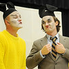Zac Angle (left) portrays Mooch the Messy as Alexander Elliott plays Mooch's father during the studio artists' Tulsa Opera on Tour performance at Monroe Elementary. Mooch the Messy is a musical written by Marcus DeLoach based on the children's book by Marjorie Weinman Sharmat. (Staff Photo by BONNIE VCULEK)