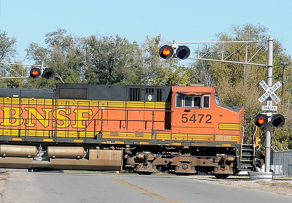 A BNSF train engine crosses N. Independence near the Railroad Museum of Oklahoma Saturday. (Staff Photo by BONNIE VCULEK)