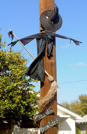 A low flying witch decorates an O.G.&E. high line pole on S. Johnson Thursday. Halloween festivities begin in downtown Enid with Scare on the Square from 5-8 p.m. Saturday. (Staff Photo by BONNIE VCULEK)