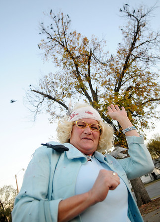 "Deedy Wichert portrays actress Tippi Helden from Alfred Hitchcock's ""The Birds"" for Halloween Wednesday, Oct. 31, 2012, in Enid, Okla. (Staff Photo by BONNIE VCULEK)"