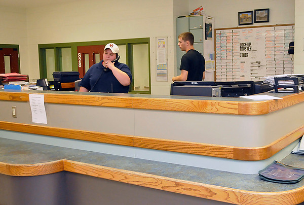 Garfield County Detention Center employees work in the booking area. (Staff Photo by BILLY HEFTON)