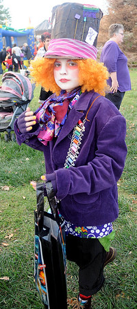 "Molly Bonham portrays the ""Mad Hatter"" during Scare on the Square Saturday. (Staff Photo by BONNIE VCULEK)"