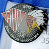 The official 2012 American Kitefliers Association 35th annual convention pen is worn proudly by kite enthusiast Alice Hayden Thursday. (Staff Photo by BONNIE VCULEK)
