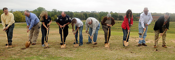 Dignitaries break-ground on the expansion for the Enid Animal Control Center Saturday. (Staff Photo by BONNIE VCULEK)