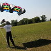 Brian C. Slater, an American Kite Association Certified Kite Pilot from East Hartford, Connecticut, secures his 30 square foot sled kite (above left) after a test flight Monday during the AKA National Convention in Enid. (Staff Photo by BONNIE VCULEK)