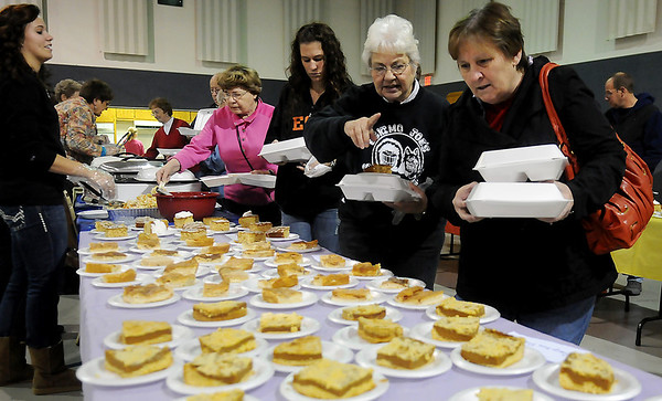 Gloria Kimak and Marilyn Embree select a sweet treat during Octoberfest at Redeemer Lutheran Church Saturday. Proceeds from the 5th annual event will be used for the renovations of the church sanctuary. (Staff Photo by BONNIE VCULEK)