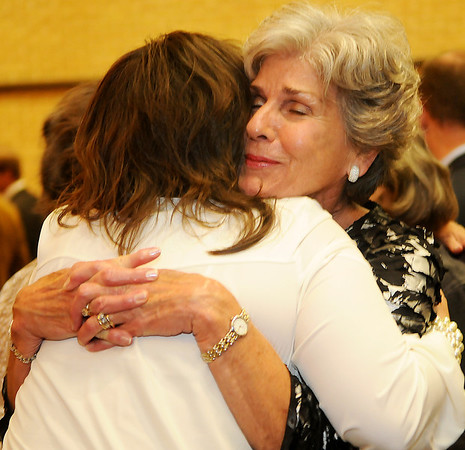 Jennifer Fields congratulates Kay Dillingham following the Enid Public School Foundation Hall of Fame Awards Banquet Tuesday at Northern Oklahoma College-Enid's Gantz Center. Kay and Dan Dillingham and Joan and Paul Allen were honored for their unselfish devotion and contributions to Enid Public Schools. (Staff Photo by BONNIE VCULEK)